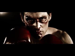 Gros plan du visage tuméfié d'un boxeur